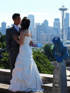 A bride and group take pictures at Kerry Park.